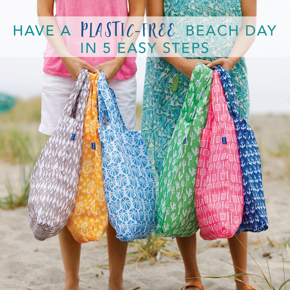 2 women holding a colorful assortment of reusable shopping on the beach