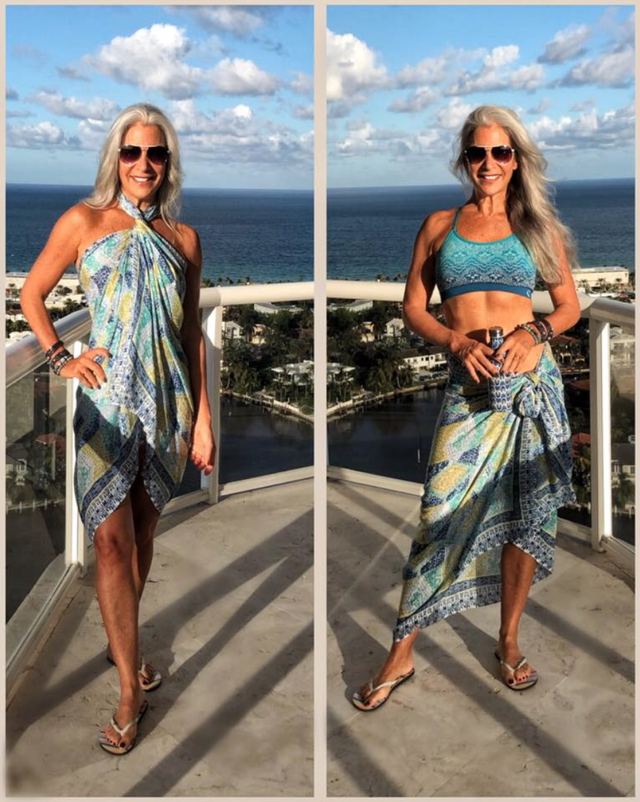 woman wearing blue scarf in 2 ways - as a halter dress and as a beach skirt