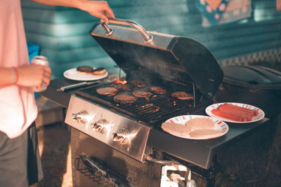 outdoor bbq man cooking burgers